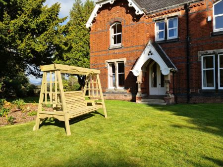 Cottage Swing Sits 3